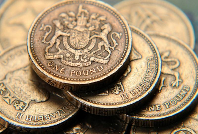 A pile of one pound coins is seen in a photo illustration