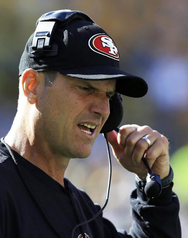San Francisco 49ers head coach Jim Harbaugh reacts during the first half of an NFL football game against the Green Bay Packers Sunday, Sept. 9, 2012, in Green Bay, Wis. (AP Photo/Jeffrey Phelps)
