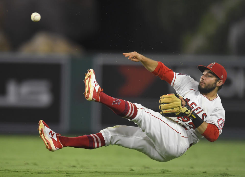 Los Angeles Angels starting pitcher Andrew Heaney makes a throw to first base but not in time to get the out on Colorado Rockies' Joshua Fuentes during the eighth inning of a baseball game Wednesday, July 28, 2021, in Anaheim, Calif. (AP Photo/John McCoy)