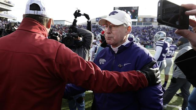 Kansas State coach Bill Snyder, right, greets Oklahoma coach Bob Stoops after their NCAA college football game Saturday, Nov. 23, 2013 in Manhattan, Kan. Oklahoma won the game 41-31. (AP Photo/Charlie Riedel)