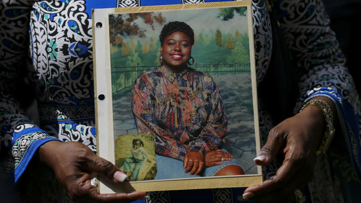Antoinette Dorsey-James holds a picture of her sister Pamela Turner during a news conference outside the Harris County Civil Court in Houston. (Godofredo A. Vasquez/Houston Chronicle via AP)