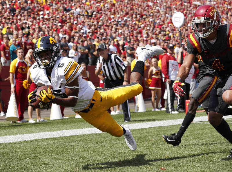 FILE - In this Sept. 9, 2017, file photo, Iowa wide receiver Ihmir Smith-Marsette (6) catches a 15-yard touchdown pass ahead of Iowa State defensive back Evrett Edwards, right, during the second half of an NCAA college football game, in Ames, Iowa. Iowa knows itll have to revamp its tight-end focused offense in 2019 after losing two of the best in school history to the NFL. Brandon Smith and Imhir Smith-Marsette will likely be the major benefactors of T.J. Hockenson and Noah Fants departures. (AP Photo/Charlie Neibergall, File)