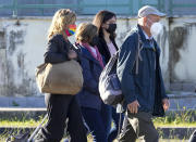 The family of slain Italian doctoral student Giulio Regeni, from right, father Claudio Regeni, Giulio's sister Irene, and his mother Paola arrive with their lawyer Alessandra Ballerini at the Rebibbia prison in Rome, Thursday, Oct. 14, 2021, to attend the first hearing of the trial for the death of Italian doctoral student Giulio Regeni, who disappeared for several days in January 2016 before his body was found on a desert highway north of the Egyptian capital. Italian prosecutors have formally put four high-ranking members of Egypt's security forces under investigation for their alleged roles in the slaying. (AP Photo/Andrew Medichini)