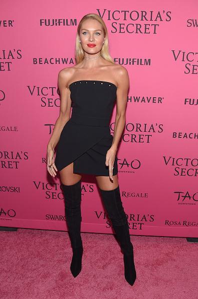 <p>Wearing boots similar to those she wore during the show just in black, Candice put on a party dress and she was ready to dance the night away. </p>