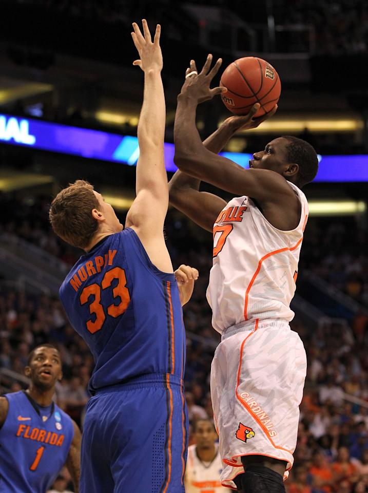 PHOENIX, AZ - MARCH 24:  Gorgui Dieng #10 of the Louisville Cardinals shoots over Erik Murphy #33 of the Florida Gators in the first half during the 2012 NCAA Men's Basketball West Regional Final at US Airways Center on March 24, 2012 in Phoenix, Arizona.  (Photo by Jamie Squire/Getty Images)