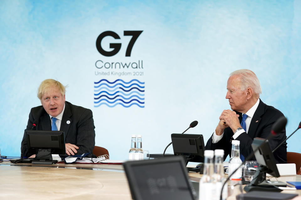 British Prime Minister Boris Johnson, left, speaks as President Joe Biden listens during the G-7 summit at the Carbis Bay Hotel in Carbis Bay, St. Ives, Cornwall, England, Friday, June 11, 2021. Leaders of the G-7 begin their first of three days of meetings on Friday, in which they will discuss COVID-19, climate, foreign policy and the economy. (Kevin Lamarque/Pool via AP)