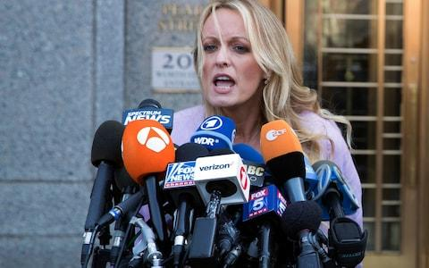 Adult film actress Stormy Daniels, speaking outside court on Monday 16 April  - Credit: Mary Altaffer/AP