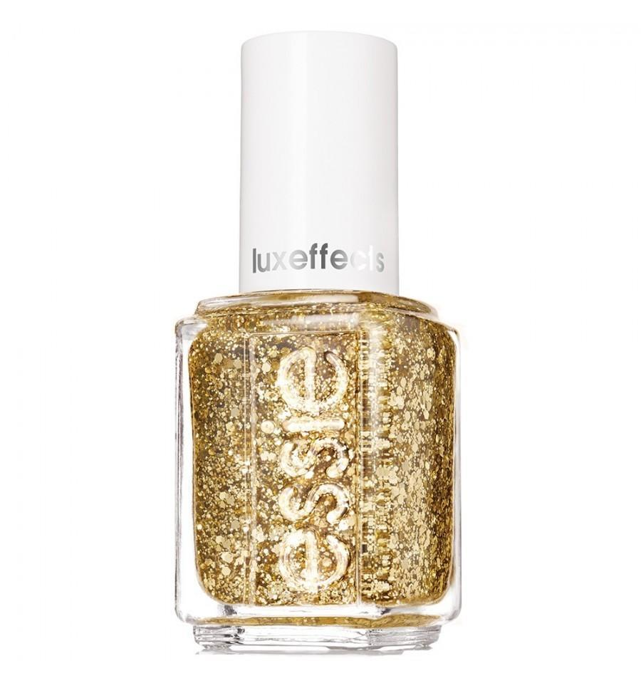 """<p>Go for a confetti effect with one coat, or layer it on for a full-on gilded manicure. <a href=""""http://www.essie.com/effects/luxeffects/rock-at-the-top.aspx"""" rel=""""nofollow noopener"""" target=""""_blank"""" data-ylk=""""slk:Essie Rock at the Top"""" class=""""link rapid-noclick-resp"""">Essie Rock at the Top</a> ($9)</p>"""