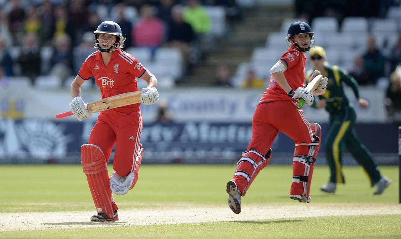 CHESTER-LE-STREET, ENGLAND - AUGUST 31: Natalie Sciver and Lydia Greenway of England score runs during the 3rd NatWest T20 match between England and Australia at Emirates Durham ICG on August 31, 2013 in Chester-le-Street, England. (Photo by Gareth Copley/Getty Images)