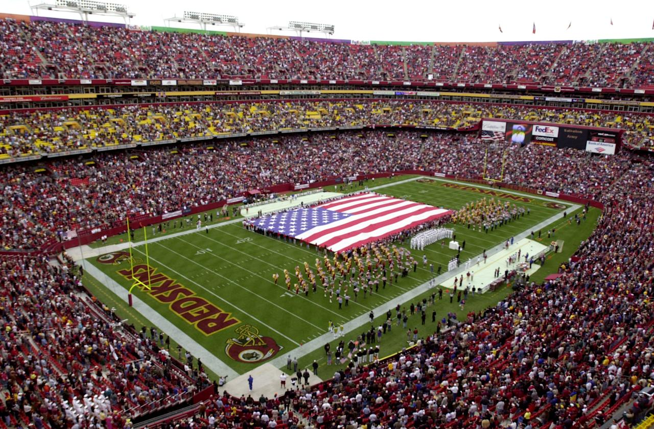 A large US Flag is unfurled by police and rescue personel involved at the Pentagon on Sept 11th prior to the game between the Washington Redskins and the Kansas City Chiefs at Fed Ex Field in Landover, Maryland. The Chiefs defeat the Redskins 45-13. DIGITAL IMAGE. Mandatory Credit: Doug Pensinger/Allsport.