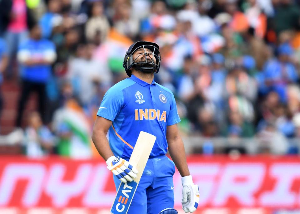 Sharma furious with himself on his way back to pavilion after falling for 140 (Photo by DIBYANGSHU SARKAR/AFP/Getty Images)