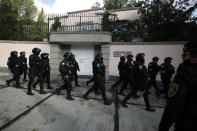 Police arrive to the scene where security secretary, Omar García Harfuch, was attacked by gunmen in the early morning hours in Mexico City, Friday, June 26, 2020. Heavily armed gunmen attacked and wounded Mexico City's police chief in a brazen operation that left an unspecified number of dead, Mayor Claudia Sheinbaum said Friday. (AP Photo/Rebecca Blackwell)