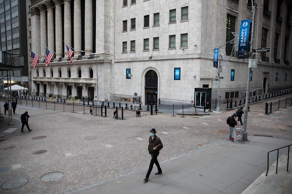 NEW YORK, Jan. 8, 2021 -- Pedestrians walk in front of the New York Stock Exchange NYSE, in New York, United States, Jan. 8, 2021. U.S. employers slashed 140,000 jobs in December, the first monthly decline since April 2020, as the recent COVID-19 spikes disrupted labor market recovery, the Labor Department reported Friday.  The unemployment rate, which has been trending down over the past seven months, remained unchanged at 6.7 percent, according to the monthly employment report. (Photo by Michael Nagle/Xinhua via Getty) (Xinhua/Michael Nagle via Getty Images)