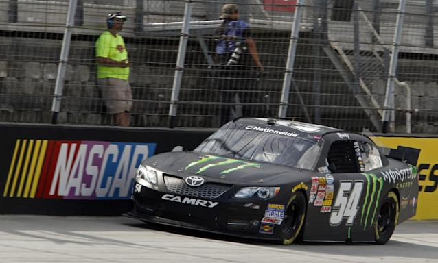 Kyle Busch (54) makes his way around the track during qualifying for the Food City 300 NASCAR Nationwide Series auto race at Bristol Motor Speedway on Friday, Aug. 22, 2014, in Bristol, Tenn. Busch will start on the pole. (AP Photo/Wade Payne)