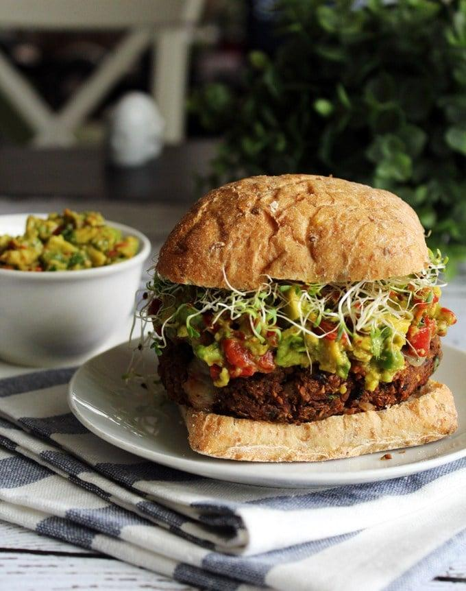"<p>If you're a fan of mushrooms, these hearty patties are for you. You can taste the rich mushrooms in every bite, along with spicy guac and crunchy lentils.</p> <p><strong>Get the recipe</strong>: <a href=""http://portandfin.com/mushroom-lentil-burgers-with-roasted-red-pepper-guacamole-sprouts/"" class=""link rapid-noclick-resp"" rel=""nofollow noopener"" target=""_blank"" data-ylk=""slk:mushroom and lentil burgers with roasted red pepper guacamole"">mushroom and lentil burgers with roasted red pepper guacamole</a></p>"
