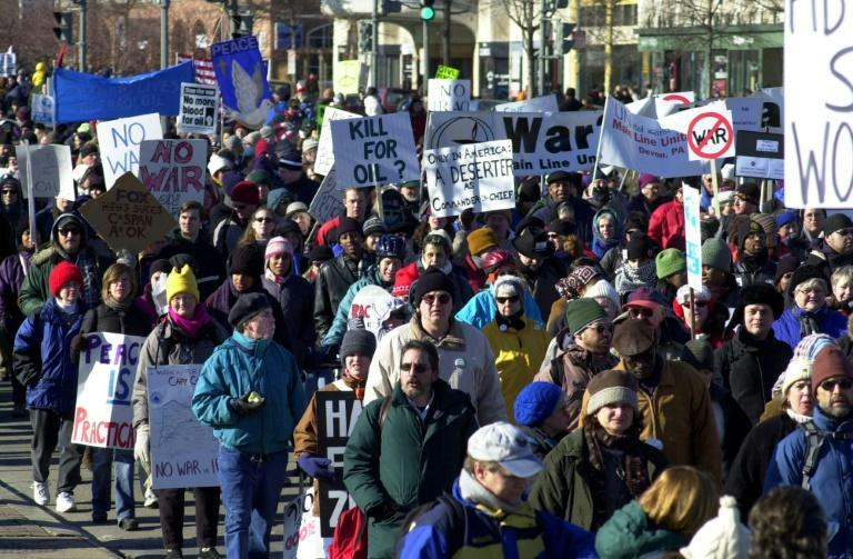 """Anti-war protesters march through the streets of Washington in January 2003, weeks before US forces invaded Iraq as part of the """"war on terror"""""""