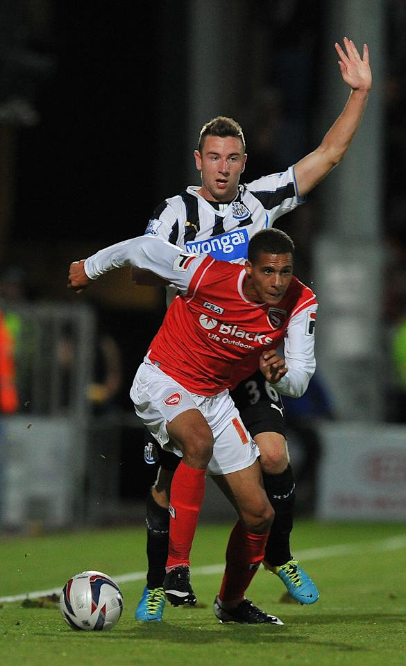 Morecambe's Marcus Marshall gets past Newcastle United's Paul Dummett during the Capital One Cup, Second Round match at the Globe Arena, Morecambe.