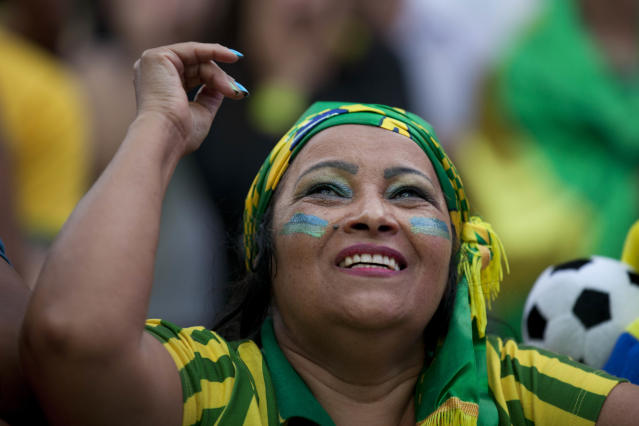A fan reacts as she watches the Mexico vs. Brazil match at the FIFA Fan Fest during the 2014 soccer World Cup in Sao Paulo, Brazil, Tuesday, June 17, 2014. Much to the disappointment of Brazil fans world wide, Mexico claimed a deserved point against Brazil in a largely frustrating Group A game which finished 0-0 at Estadio Castelao in Fortaleza. (AP Photo/Dario Lopez-Mills)