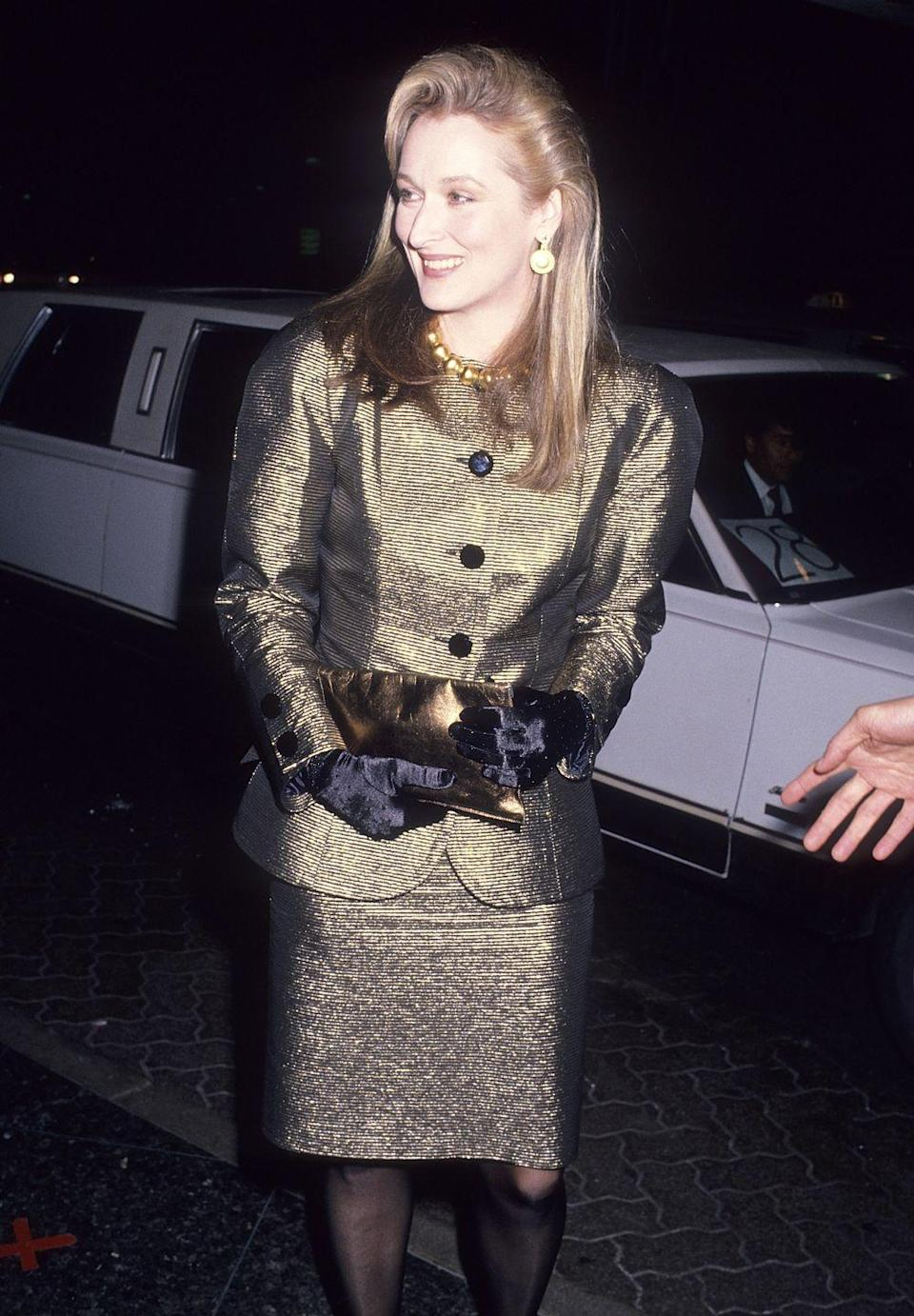 <p>Meryl Streep shimmered in a gold skirt suit in 1989.</p>