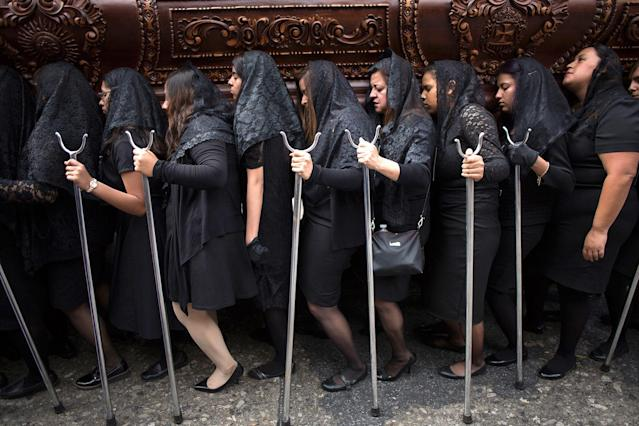 "<p>Devotees carry a religious float with a statue of the Virgin Mary of Sorrow during the Jesus of Nazareth procession from La Merced church in downtown Guatemala City, Tuesday, March 27, 2018. The procession is known as ""La Resena"" is one of the country's earliest Catholic processions, the first being recorded in 1721. (Photo:Moises Castillo/AP) </p>"