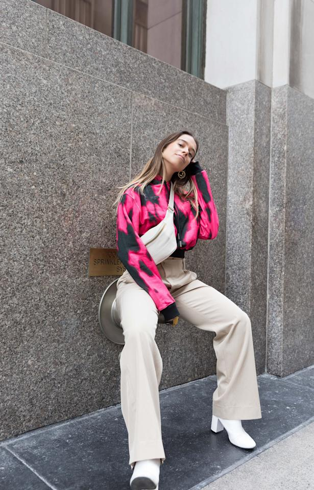 <p>I styled this cropped Off-White hoodie with high-waist trousers, white block-heel boots I've been wearing for years (They're from H&amp;M!), a waist bag strapped across my chest, and gold hoop earrings. I honestly felt effortless as I walked out the door. This was, hands down, my favorite Fashion Week look.</p> <p><strong>Hot Tip</strong>: Try wearing one of your cropped sweatshirts with a tailored, neutral slack instead of jeans. Even if the print on your hoodie is playful, a quality-made pant will instantly elevate the outfit.</p>