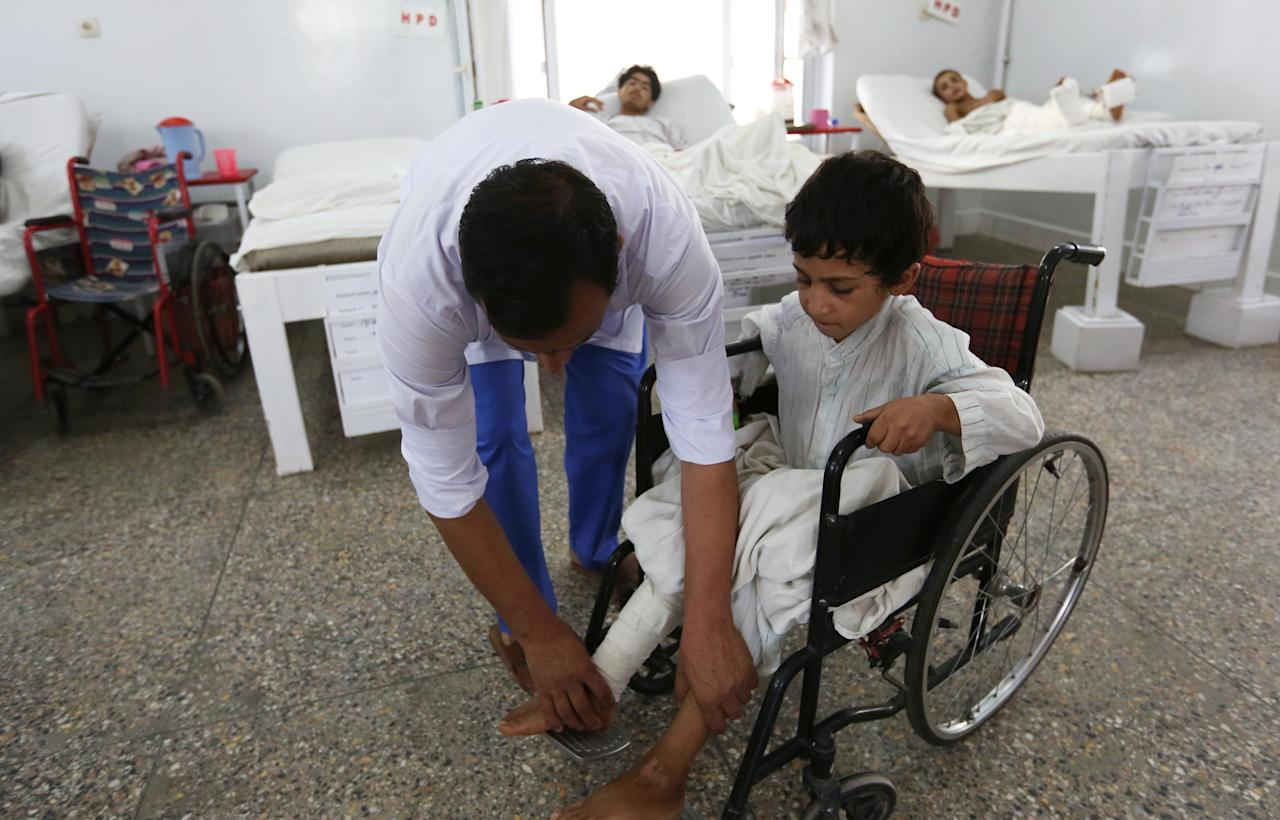 Afghan child war victims receive treatment at the Emergency Hospital in Kabul, Afghanistan, Monday, July 25, 2016. The United Nations mission in Afghanistan says the number of children killed or wounded in the country's conflict has surged in the first half of this year, compared to last year. (AP Photo/Rahmat Gul)