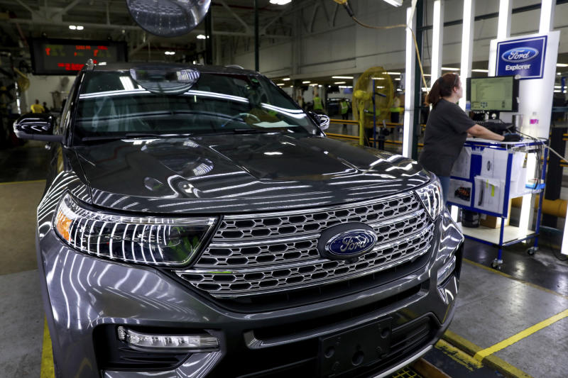 FILE - In this June 24, 2019, file photo Ford's employees work on a Ford Explorer line at Ford's Chicago Assembly Plant in Chicago. On Tuesday, Sept. 17, the Federal Reserve reports on U.S. industrial production for August. (AP Photo/Amr Alfiky, File)