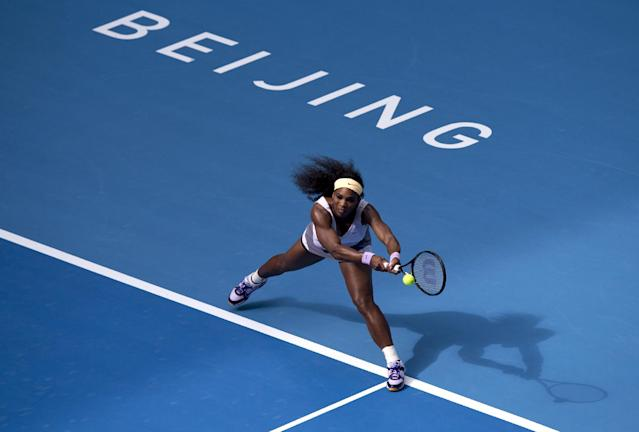 Serena Williams of the U.S. returns a shot to Francesca Schiavone of Italy during the second round of the China Open tennis tournament at the National Tennis Stadium in Beijing, China Tuesday, Oct. 1, 2013. (AP Photo/Andy Wong)