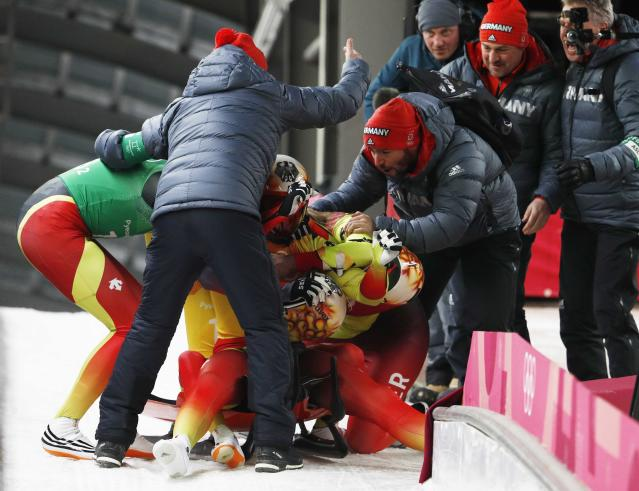 Luge - Pyeongchang 2018 Winter Olympic Games - Team Relay - Pyeongchang, South Korea - February 15, 2018 - Gold medalists Natalie Geisenberger, Johannes Ludwig, Tobias Wendl and Tobias Arlt of Germany celebrate. REUTERS/Edgar Su