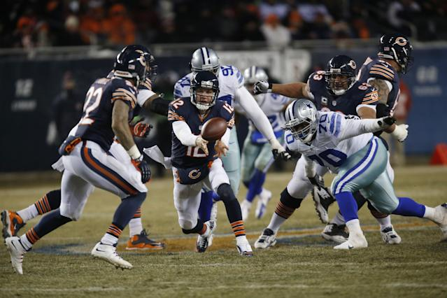 Chicago Bears quarterback Josh McCown (12) pitches the ball to running back Matt Forte (22) during the second half of an NFL football game against the Dallas Cowboys, Monday, Dec. 9, 2013, in Chicago. (AP Photo/Charles Rex Arbogast)