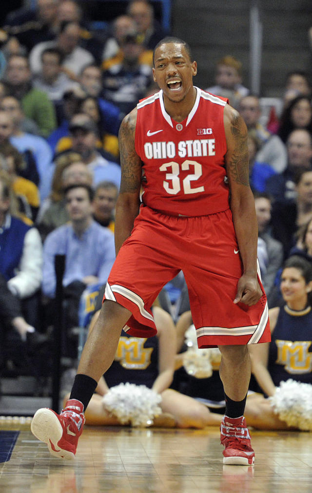 Ohio State's' Lenzelle Smith Jr. (32) celebrates a basket against Marquette during the second half of an NCAA college basketball game Saturday, Nov. 16, 2013, in Milwaukee. Ohio State defeated Marquette 52-35. (AP Photo/Jim Prisching)