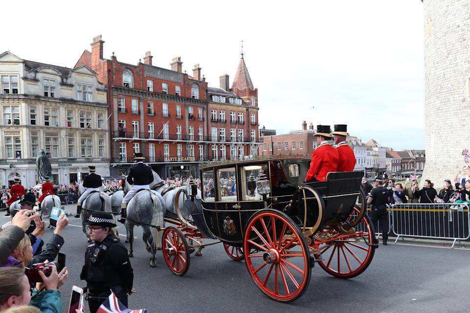 <p>They also chose a closed-top carriage. Photo: Getty </p>