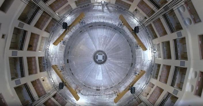 At the heart of ITER is its Tokamak, a round chamber 100 feet across that will contain the world's largest system of superconducting magnets. / Credit: ITER.org