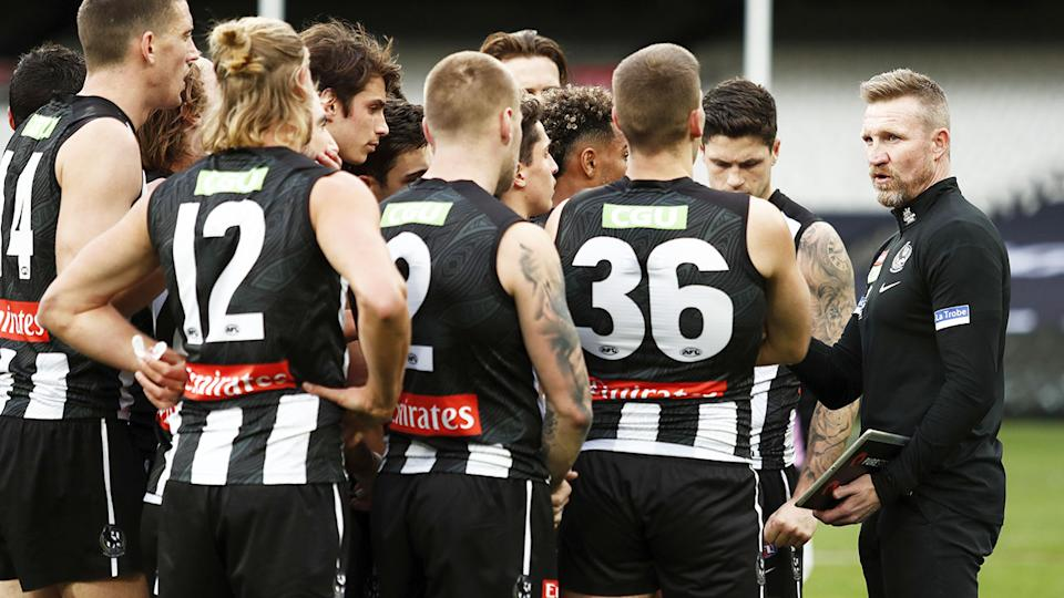 Nathan Buckley, pictured here addressing his players during Collingwood's clash with Geelong.
