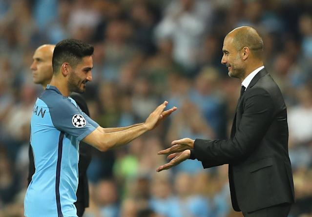 Ilkay Gundogan with Pep Guardiola
