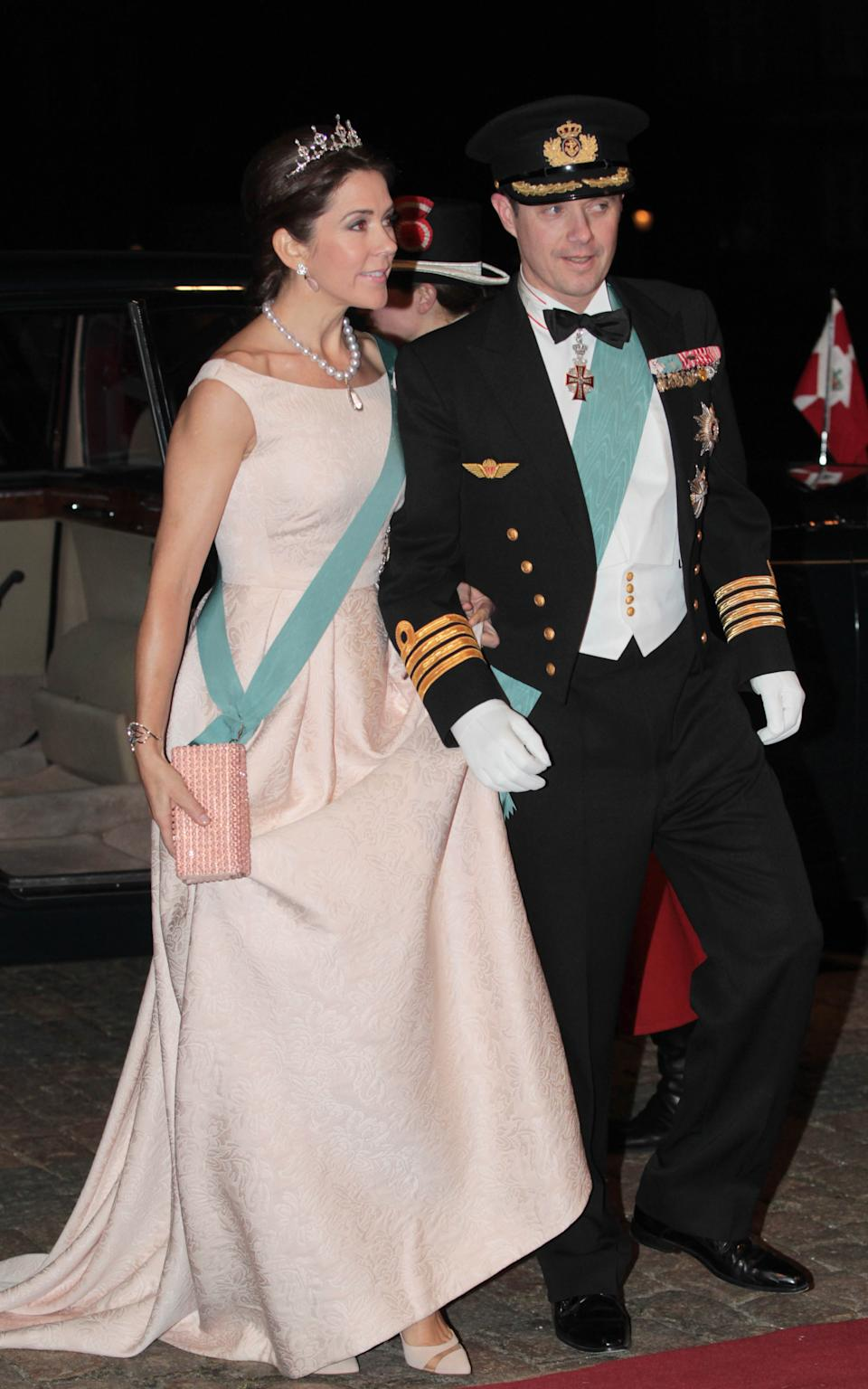 Frederik (R), Crown Prince of Denmark and his wife Crown Princess Mary (L) arrive at Amalienborg Palace for a dinner in honor of Turkish President Abdullah Gul and his wife Hayrunnisa Gul given by Queen Margrethe II and her husband Prince Henrik in Copenhagen, Denmark on March 17, 2014. (Photo by Mehmet Kaman/Anadolu Agency/Getty Images)