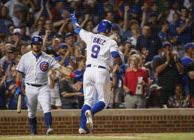 Chicago Cubs' Javier Baez (9) reacts as he crosses home plate after hitting a solo home run against the Oakland Athletics during the sixth inning of a baseball game, Monday, Aug. 5, 2019, in Chicago. (AP Photo/Kamil Krzaczynski)