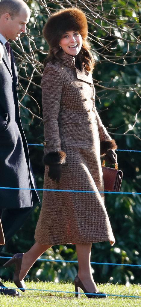 <p>Kate Middleton joined the Duke of Cambridge and his grandfather the Duke of Edinburgh for church service on Sunday 7 January, 2018. For the outing, the Duchess of Cambridge donned a tweed knee-skimming coat accessorised with her go-to burgundy Chanel bag. <em>[Photo: Getty]</em> </p>