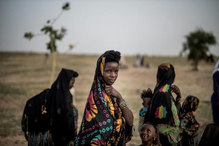The Fulani are pastoral herders who migrate with their cattle, following the pendulum swing of the seasons (AFP Photo/Marco LONGARI)
