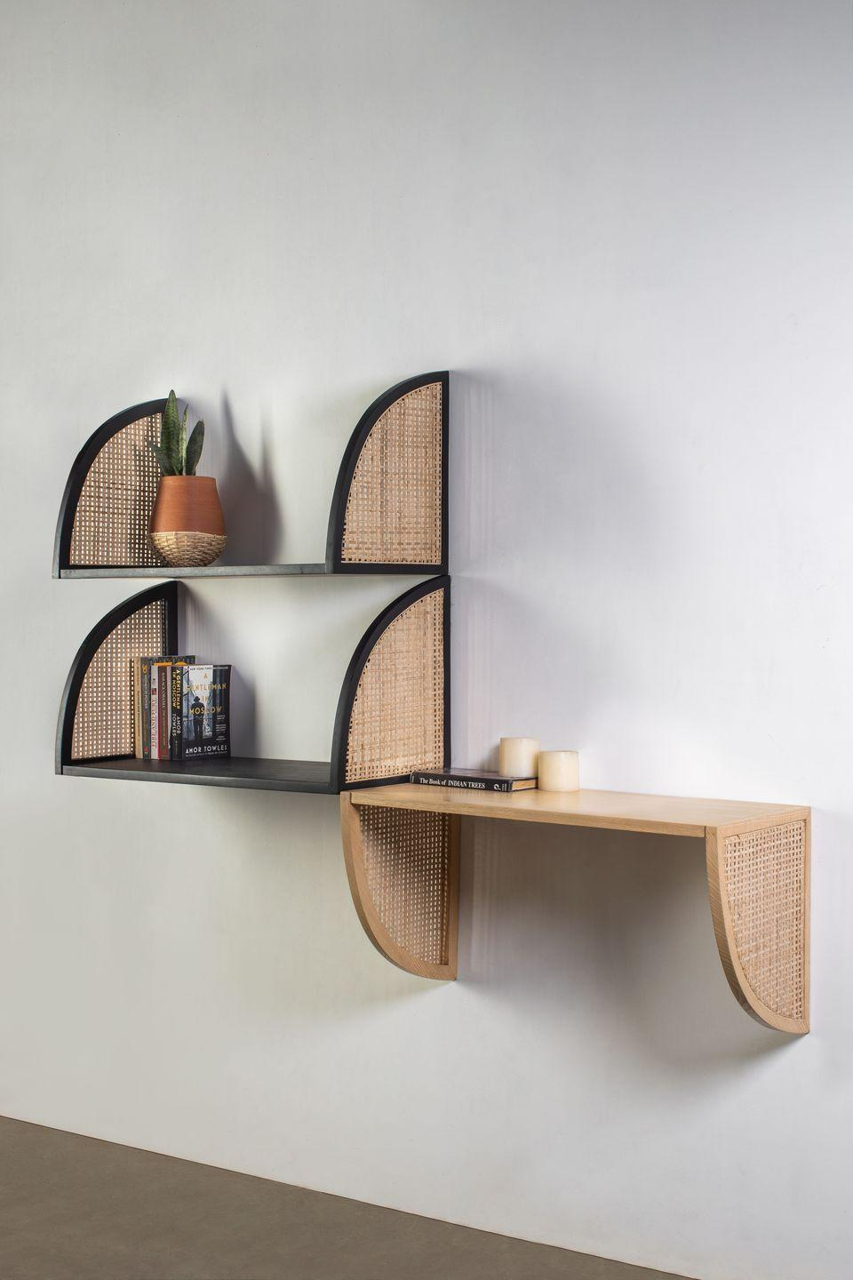 """<p>Picking up where its 2019 debut collection left off, Kam Ce Kam's latest pieces employ traditional Indian craftsmanship to contemporary effect. Black and natural ash-framed rattan takes a starring role in the form of the 'Aaram' reversible shelves, lending spaces an airy feel. From £270, <a href=""""https://kamcekam.com/"""" rel=""""nofollow noopener"""" target=""""_blank"""" data-ylk=""""slk:kamcekam.com"""" class=""""link rapid-noclick-resp"""">kamcekam.com</a></p>"""