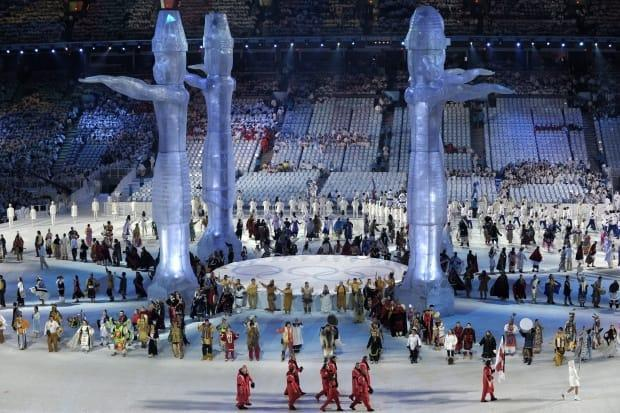 Welcome Poles and Indigenous performers appear at the opening ceremony for the 2010 Vancouver Winter Olympics.