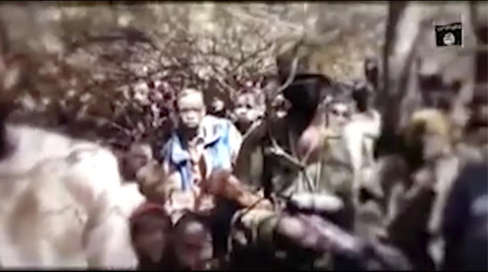 In this image made from an undated video provided by Boko Haram, boys are seen in an undisclosed location. A video allegedly released on Thursday, Dec. 17 2020 by Nigeria's jihadist rebels, Boko Haram, shows a group of boys under trees, speaking to a person filming them. Last week more than 300 students were kidnapped from a school in Kankara, in the north of the country, the children in the video are supposed to be those abducted last Friday. (Boko Haram/Militant Video via AP)
