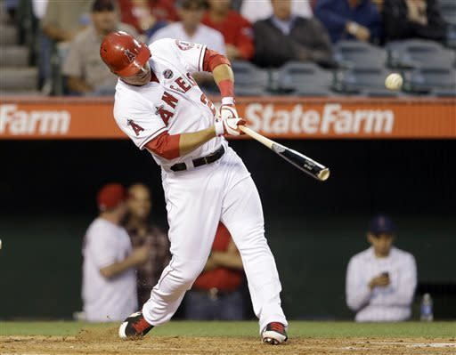Los Angeles Angels' Mike Trout connects on a long sacrifice fly to right that batted in J.B. Schuck against the Houston Astros in the third inning of a baseball game in Anaheim, Calif., Monday, June 3, 2013. (AP Photo/Reed Saxon)
