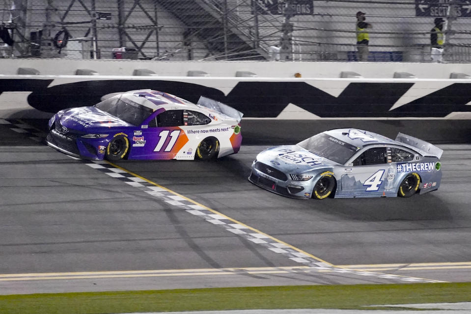 Denny Hamlin wins the second stage ahead of Kevin Harvick during the NASCAR Daytona 500 auto race at Daytona International Speedway, Sunday, Feb. 14, 2021, in Daytona Beach, Fla. (AP Photo/John Raoux)