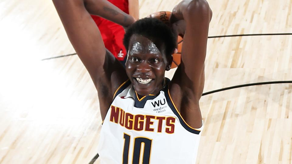 Denver Nuggets rookie Bol Bol is pictured rising up for a slam dunk against the Washington Wizards.