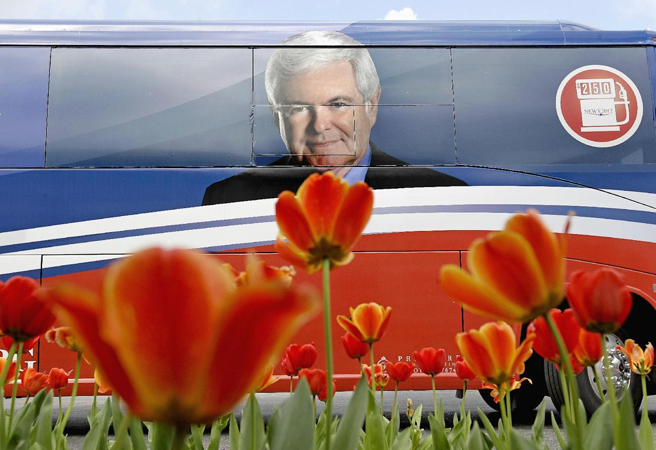 The tour bus of Republican presidential candidate former House Speaker Newt Gingrich waits for his return outside a campaign event, Tuesday, March 13, 2012, in Vestavia Hills, Ala. (AP Photo/David Goldman)