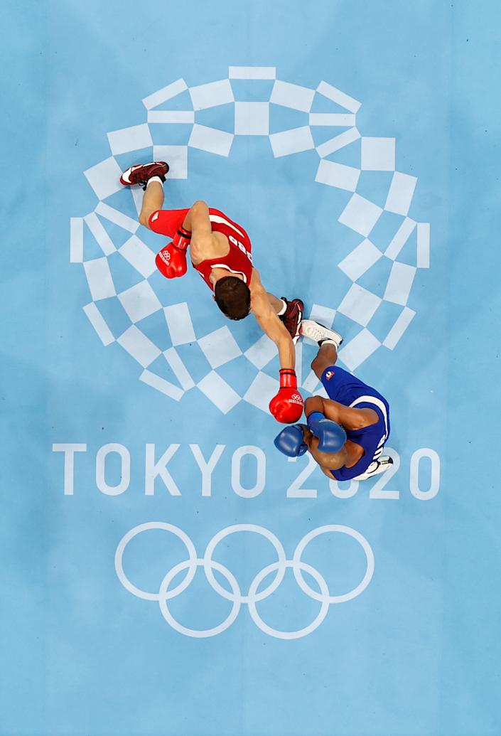 <p>TOKYO, JAPAN - AUGUST 03: Pat McCormack (red) of Team Great Britain exchanges punches with Roniel Iglesias of Team Cuba during the Men's Welter (63-69kg) final on day eleven of the Tokyo 2020 Olympic Games at Kokugikan Arena on August 03, 2021 in Tokyo, Japan. (Photo by Ueslei Marcelino - Pool/Getty Images)</p>