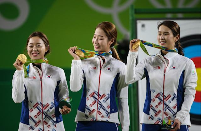 <p>Gold medalists Hyejin Chang, Choi Mi-sun, Ki Bo-Bae (L-R) of South Korea pose at a victory ceremony for the women's team archery event at the Rio 2016 Summer Olympic Games, at Sambodromo. Valery Sharifulin/TASS (Photo by Valery SharifulinTASS via Getty Images) </p>