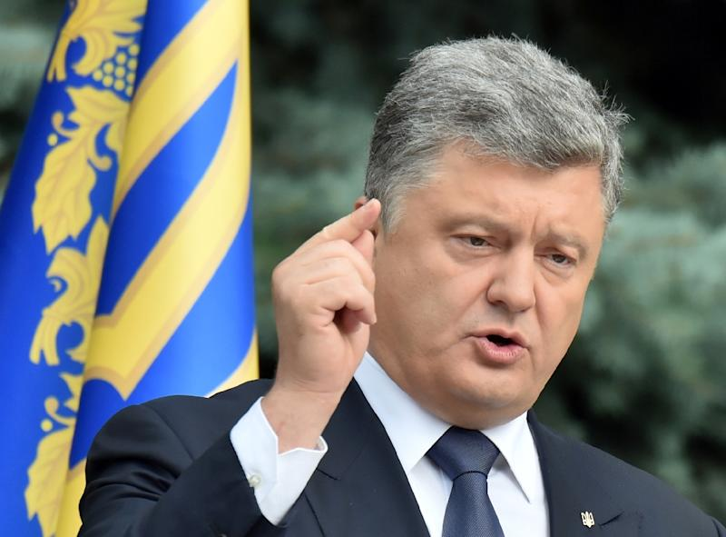 "President Petro Poroshenko, pictured on July 1, 2015, said that Merkel and Hollande had ""recommended that the president of Ukraine continue with (his) constitutional reforms"" (AFP Photo/Sergei Supinsky)"