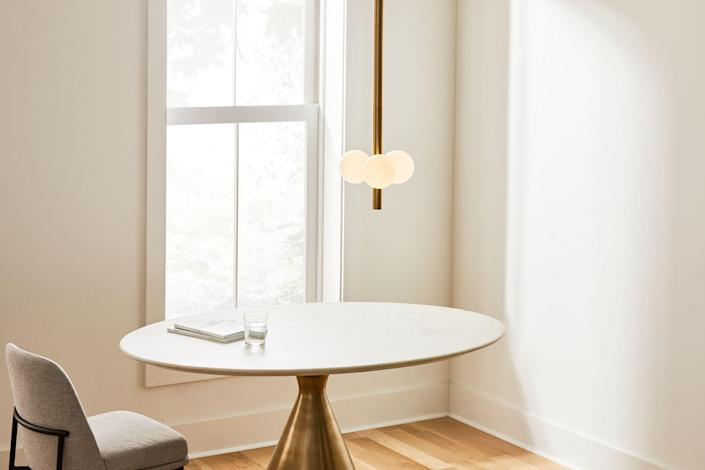 """The pendant is a personal favorite of Danny's. The piece is equipped with integrated, long-lasting LED lights so you won't have to worry about changing the bulbs. $399, West Elm. <a href=""""https://www.westelm.com/products/bower-led-3-light-pendant-antique-brass-h6064/"""" rel=""""nofollow noopener"""" target=""""_blank"""" data-ylk=""""slk:Get it now!"""" class=""""link rapid-noclick-resp"""">Get it now!</a>"""